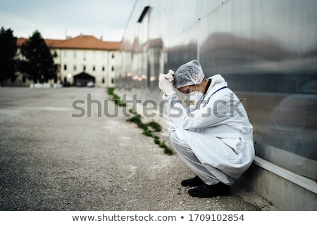 sad depressed medical nurse having stress breakdown stock photo © deandrobot