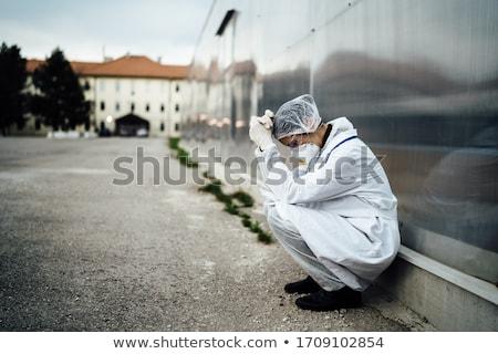 Stock photo: Sad depressed medical nurse having stress breakdown