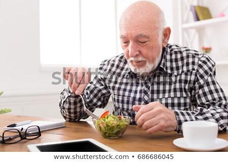 kıdemli · adam · gülen · kamera · yeme · salata - stok fotoğraf © monkey_business