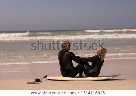 вид сбоку улыбаясь старший человека сидят доска для серфинга Сток-фото © wavebreak_media
