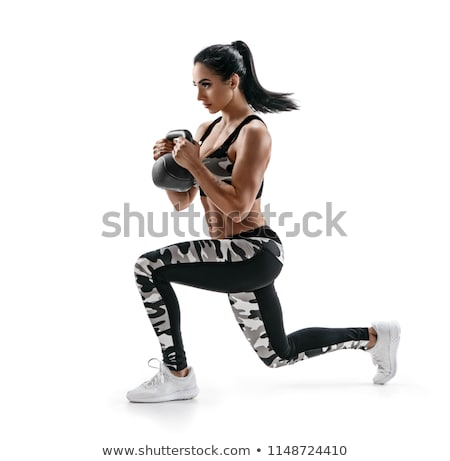 side view of athletes lifting kettlebells stock photo © wavebreak_media