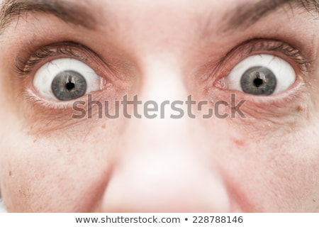 big eyes and wide open mouth, A man looks at something Stock photo © studiostoks
