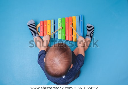 baby and music stock photo © fisher