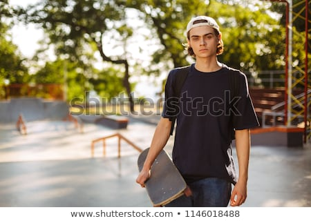 Portré férfi tinédzser fickó tart gördeszka Stock fotó © deandrobot