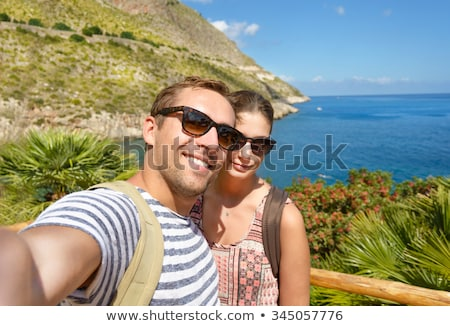 man & woman on phone during hike Stock photo © IS2