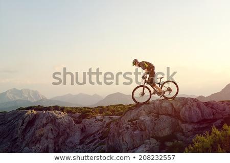 Homem mountain bike montanhas viajar bicicleta rio Foto stock © IS2