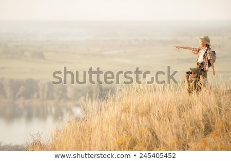 Group of kids looking at the horizon Stock photo © IS2