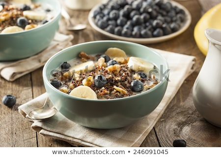 Dietary natural breakfast with natural organic ingredients - strawberries, granola, banana in a glas Stock photo © artjazz