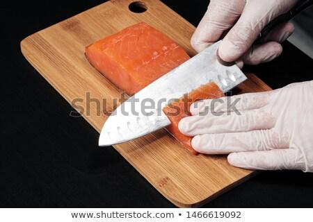 man slicing smoked salmon fish fillet Stock photo © dolgachov