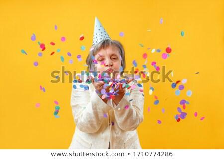 Grappig oude vrouw vieren verjaardagsfeest confetti vector Stockfoto © pikepicture