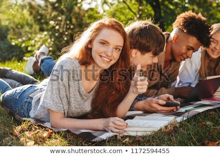 Csoport energikus diákok házi feladat együtt park Stock fotó © deandrobot