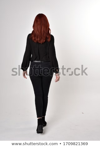 Stockfoto: Portrait Of Beautiful Red Haired Woman Posing At Camera And Touching By Arms With Red Manicure Her F