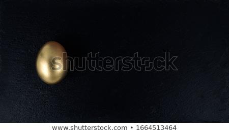 black and gold eggs stock photo © grafvision