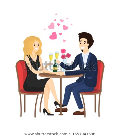 Dating Couple in Evening Gowns Sitting at Table Stock photo © robuart