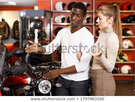 portrait of joyous couple man and woman riding on motorbike tog stock photo © deandrobot