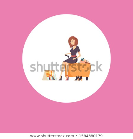 Shopping Woman Sits on Footstool Trying on Shoes Stock photo © robuart