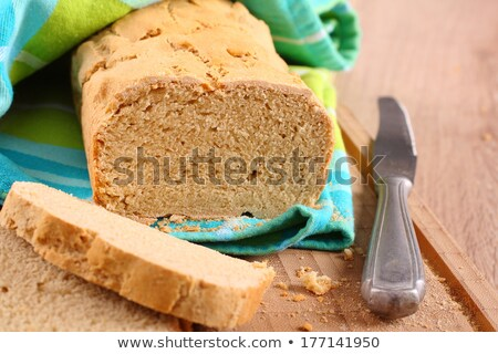 Fresh from the oven gluten free bread on a cutting board Stock photo © Melnyk