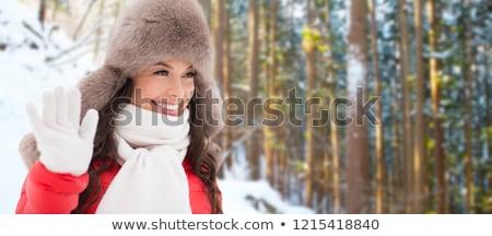 happy woman in winter fur hat waving hand outdoors Stock photo © dolgachov