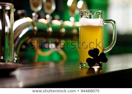 Közelkép üveg sör shamrock asztal Szent Patrik napja Stock fotó © dolgachov