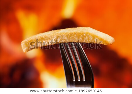 One french fry on a fork on fire background - close up Stock photo © lightkeeper