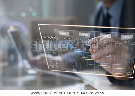 Adam planlama zamanlamak dizüstü bilgisayar ofis Stok fotoğraf © AndreyPopov
