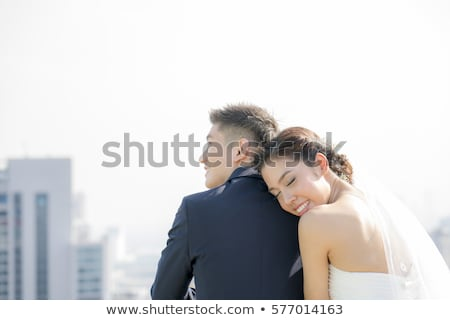 glimlachend · bruid · steeg · boeket · prachtig · jonge - stockfoto © szefei
