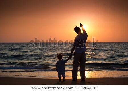 Adam plaj bakıyor deniz işaret havlu Stok fotoğraf © pedromonteiro