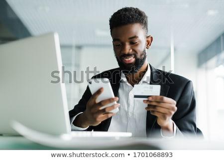 szczęśliwy · człowiek · za · pomocą · laptopa · karty · kredytowej · przystojny · mężczyzna - zdjęcia stock © photography33