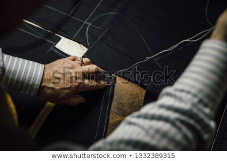 detail of tailor's hand with chalk Stock photo © caimacanul