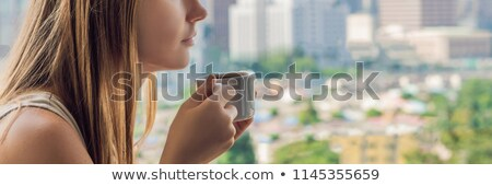 Woman drinking from coffee bowl Stock photo © photography33