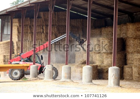 tractor lifting bail of hay stock photo © photography33