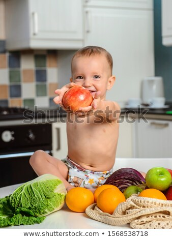 child with an appetite for eating an apple Stock photo © OleksandrO