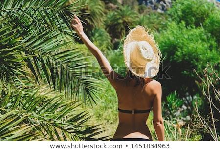 Gyönyörű szőke nő fehér bikini pózol tengerpart Stock fotó © bartekwardziak