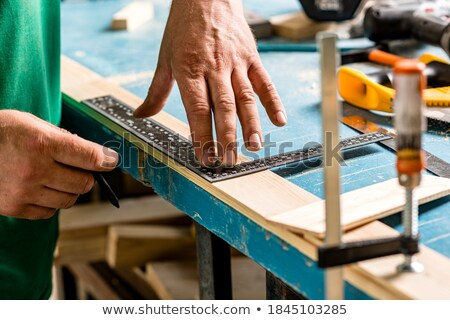 carpenter marking wood before sawing stock photo © photography33