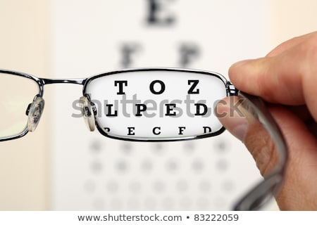 mano · gafas · examen · de · la · vista · blanco - foto stock © redpixel