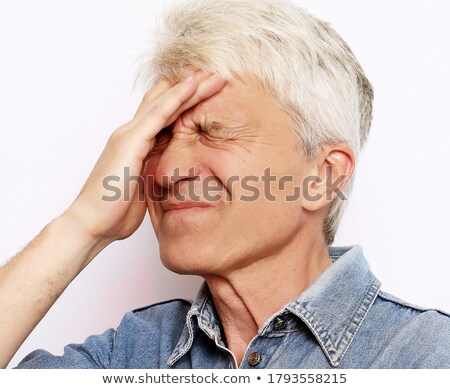 Man in his sixties having chest pain Stock photo © sumners