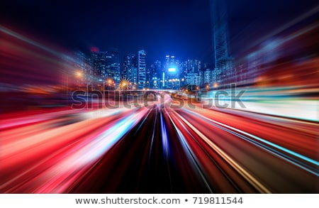 Abstract motion blurred lights on blue Stock photo © lunamarina