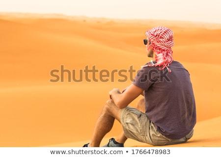 young man is relaxing outdoor in dune in summer stock photo © juniart