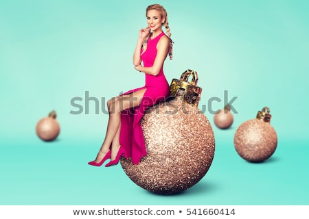 lovely woman with christmas balls stock photo © dolgachov