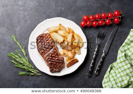Gesneden lendenen rundvlees plaat vork mes Stockfoto © shutswis