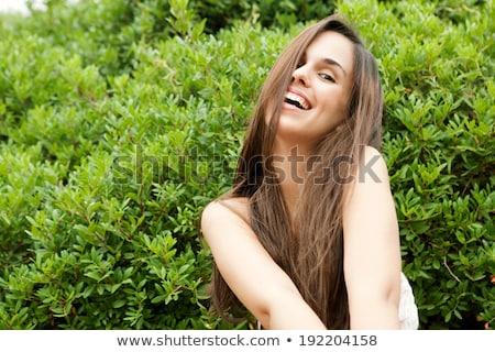 Atrakcyjna kobieta zielone bikini ekspresyjny wskazując kopia przestrzeń Zdjęcia stock © stockyimages