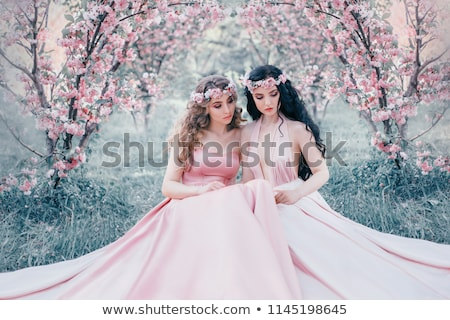 Two pretty blonde sitting on a tree branch Stock photo © acidgrey