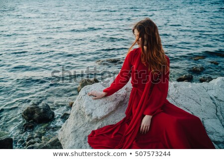 Fashion brunette model posing in white dress with red roses skir Stock photo © Victoria_Andreas
