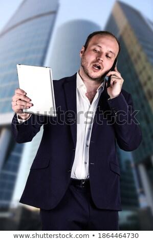 серьезный · молодые · бизнесмен · глядя · далеко · далеко - Сток-фото © wavebreak_media