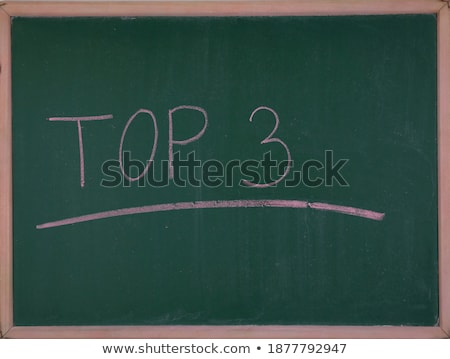 Winning pedestal on green chalkboard Stock photo © stevanovicigor
