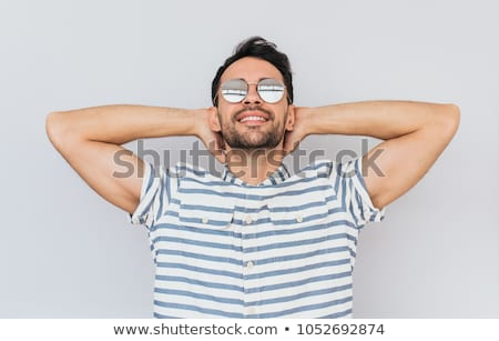 casual man poses with hands behind head stock photo © feedough