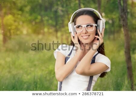 Nerdy woman listening to music Stock photo © stokkete