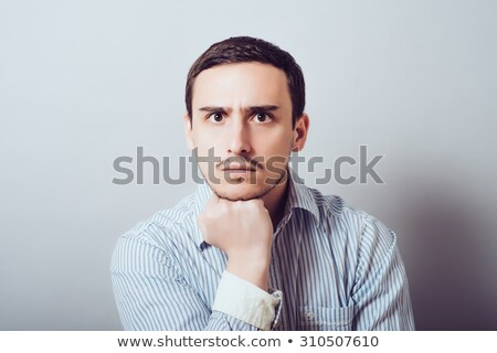 casual man touches his chin and smiles Stock photo © feedough