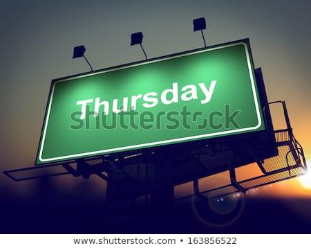 Thursday - Billboard on the Sunrise Background. Stock photo © tashatuvango