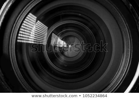 camera lens and image on black background stock photo © redpixel